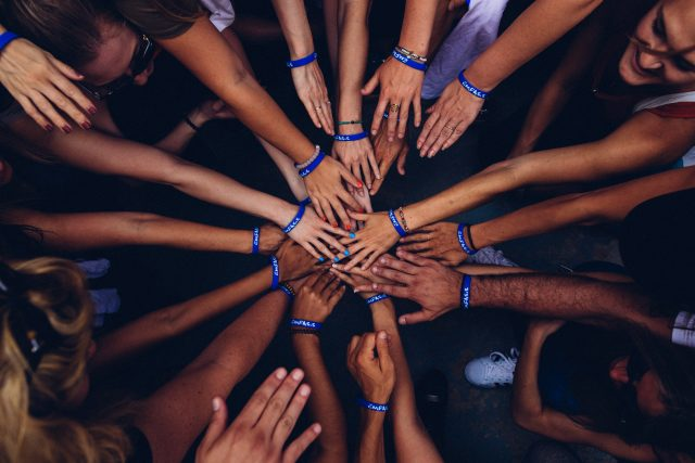 Team's hands together in a circle